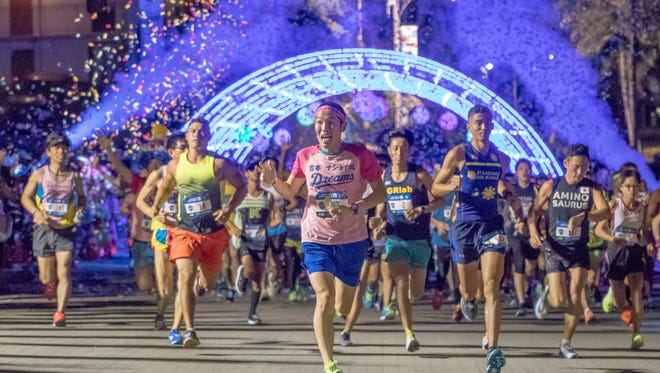 Marathon course runners take off at the starting line at 3 a.m. April 8 in the 2018 United Airlines Guam Marathon.