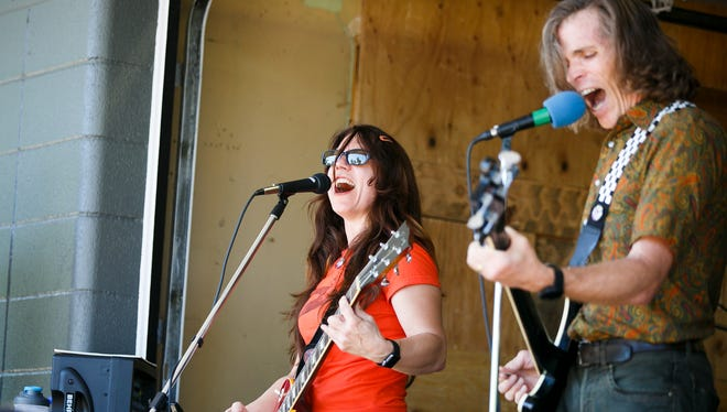 Karen Holman and David Fox of City of Pieces perform at Barnwood Naturals for Make Music Day in Downtown Salem on Wednesday, June 21, 2017. Make Music Day is a global celebration of making music that takes place every year on June 21.