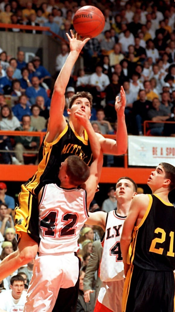 Mike Miller plays for Mitchell in 1998.