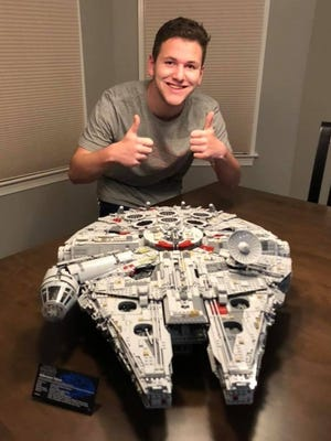 Matthew Fiore, 17, of Grafton, with the Millennium Falcon he built from a Lego Star Wars kit.