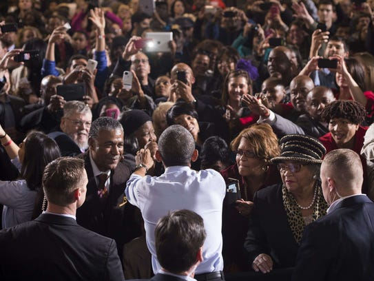 President Barack Obama greets supporters after speaking