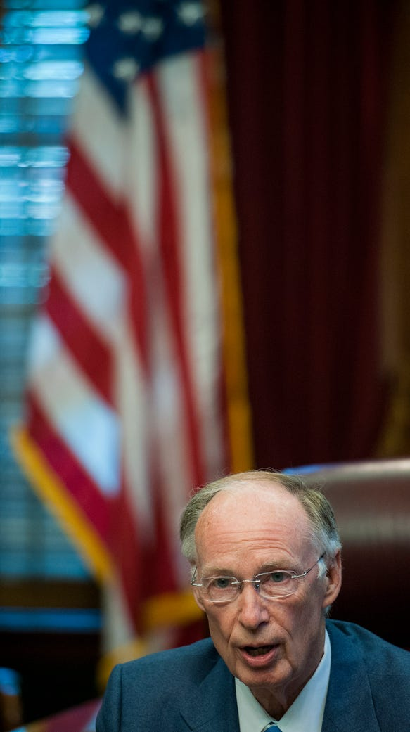 Governor Robert Bentley speaks with the media about