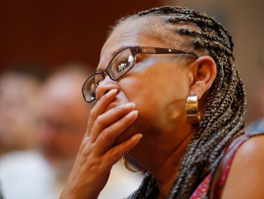 Cheryl Clay, president of the Springfield NAACP, listens
