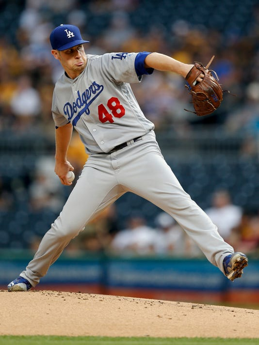 Los Angeles Dodgers starter Brock Stewart pitches against the Pittsburgh Pirates during the first inning of a baseball game, Tuesday, Aug. 22, 2017, in Pittsburgh. (AP Photo/Keith Srakocic)