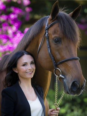 Georgina Bloomberg with her Australian-bred show-jumper Tulara Colmine at her barn in Wellington on Feb. 18, 2019.