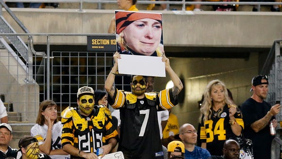 Pittsburgh Steelers fans hold up a sign of the infamous