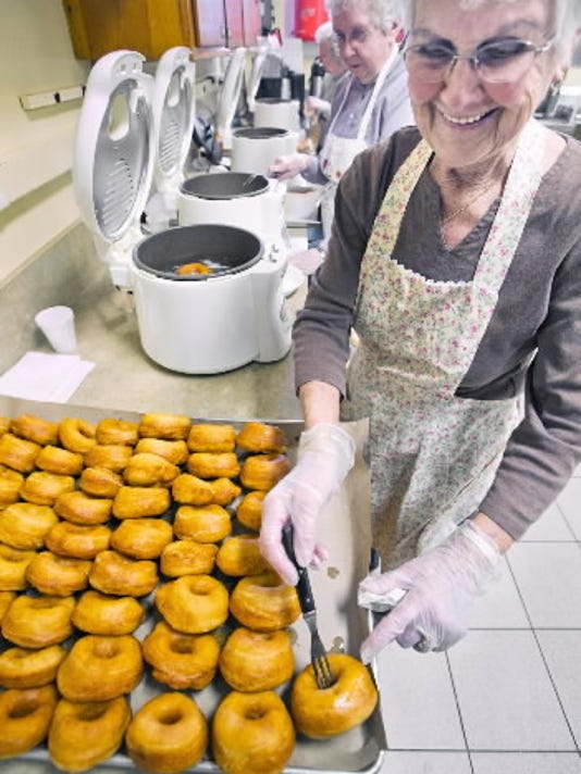 Hazel Cook-Hammers, of Red Lion, made fastnachts last year for the Stewartstown Senior Center. A line of cooks were frying the dough at a church in Stewartstown. The group has been making fastnachts for 20 years. YORK DAILY RECORD/SUNDAY NEWS - PAUL KUEHNEL