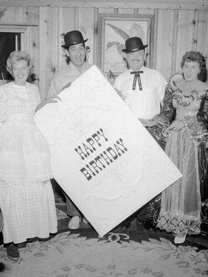 Vineland marked it's 100th birthday in August 1961 with a month-long celebration. Mrs. and Mr. Leonard Jones and Mr. and Mrs. John Duffy display a giant birthday card during the festivities.