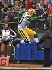 Green Bay Packers cornerback Damarious Randall (23) leaps into the end zone after making an interception against the Oakland Raiders during Sunday's game at O.co Coliseum stadium in Oakland, Calif.