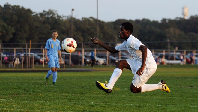 Sussex Central's Dalendy Dupervil flys through the air to control a ball against Cape Henlopen on Thursday, Oct. 8.