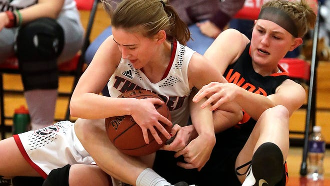 West DePere senior Hannah Stefaniak battles for a loose ball against Seymour senior McKendra Heinke during a Bay Conference girls basketball game on Jan. 26 at Seymour.