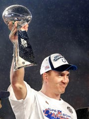 Colts QB and MVP Peyton Manning hoists the Vince Lombardi Trophy in the air after the Colts beat Chicago during Super XLI at Dolphins Stadium in Miami on Feb. 4, 2007.