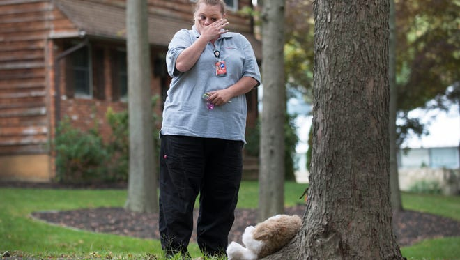 Cindy Kimmerley of Gloucester City wipes away a tear Wednesday afternoon as she visits a  memorial for 3-year-old Brendan Link Creato located in Cooper River Park in Haddon Township near where Brendan's body was found Tuesday morning.  10.14.15