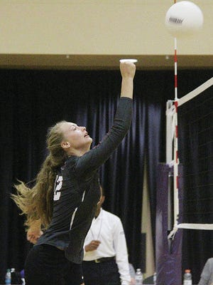 Maddy McKinney delivers a strong hit for the Oklahoma Wesleyan University volleyball team last fall. Mike Tupa/Examiner-Enterprise