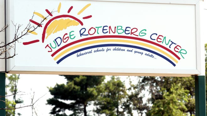 The exterior sign for the Judge Rotenberg Center in Canton, a behavioral school for children and young adults.