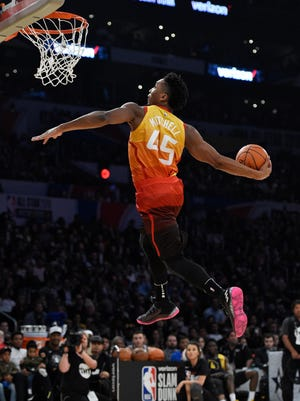 Utah Jazz's Donovan Mitchell goes up for a dunk during the NBA basketball All-Star weekend slam dunk contest Saturday, Feb. 17, 2018, in Los Angeles. Mitchell won the event. (AP Photo/Chris Pizzello)