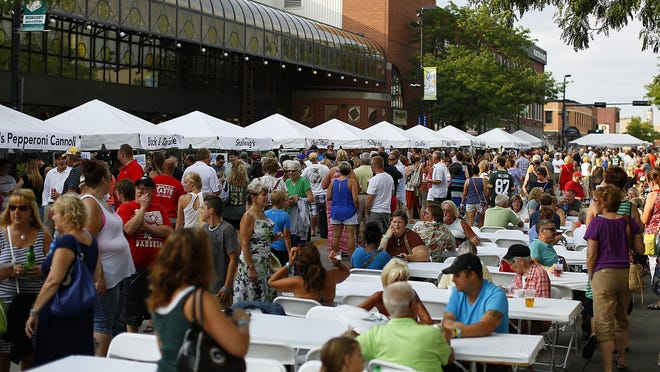 People gather at Taste on Broadway in downtown Green Bay.