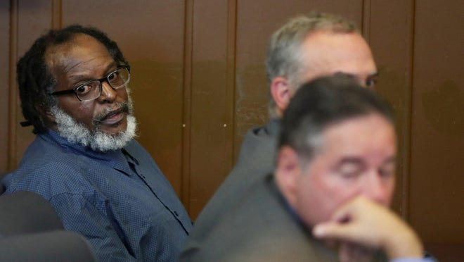 Stanley Ford looks towards the prosecutors as he sits with his attorneys Joe Gorman, front, and Scott Rilley during a status hearing in Summit County Common Pleas Judge Christine Croce's court on Sept. 24, 2019 in Akron, Ohio. Ford's murder trial, scheduled to restart Tuesday, has been postponed again. [Mike Cardew/Beacon Journal file photo]]