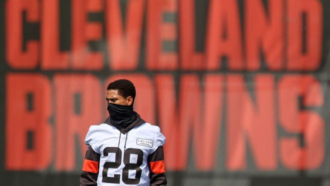 Cleveland Browns cornerback Kevin Johnson watches practice from the sideline at the NFL team's training facility, Tuesday, Aug. 25, 2020, in Berea, Ohio.