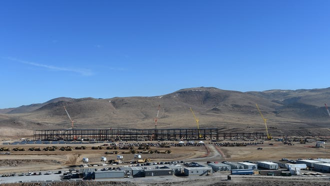 Construction crews work on Tesla Motors' gigafactory battery plant at the Tahoe-Reno Industrial Center on Jan. 8, 2014.