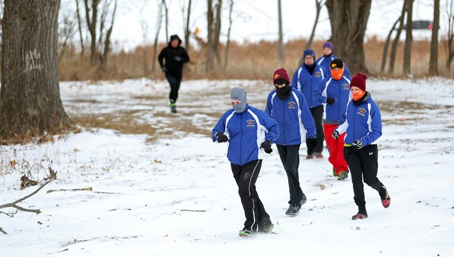 Members of the C.S. Turkeys run a trail in Brown's Woods Sunday morning, January 5, 2014 at about 8am with a temperature of 1 degree F. From left is Mike Peverill, Amber Crews, Seth Nostrala, Justin Nostrala, Dale Finnegan, Charlie Huynh and Natalie McLain.