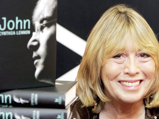 Cynthia Lennon, the first wife of Beatle's band member John Lennon, sits behind copies of her newly released book entitled 'John' during a book signing at Foyle's bookshop in central London on Sept 26, 2005.