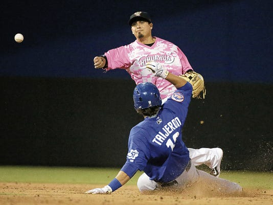 RUBEN R RAMIREZ—EL PASO TIMES Chihuahuas shortstop Ramiro Pena delivers the ball for a double play on Las Vegas 51's right fielder Travis Taijeron during action in the the first game of a four game homestand.