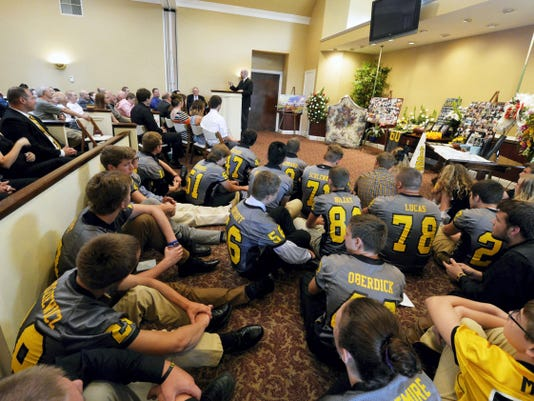 With no room remaining in an adjacent overflow room, Red Lion football players sit on the floor near the front of the chapel during a celebration of life service for Nick Mankin. A rising senior, Mankin and another football player, Stone Hill, were killed in a car crash in Lower Chanceford Township on Tuesday. Saturday's services were held at Life Tributes by Olewiler & Heffner Funeral Chapel & Crematory in York Township.