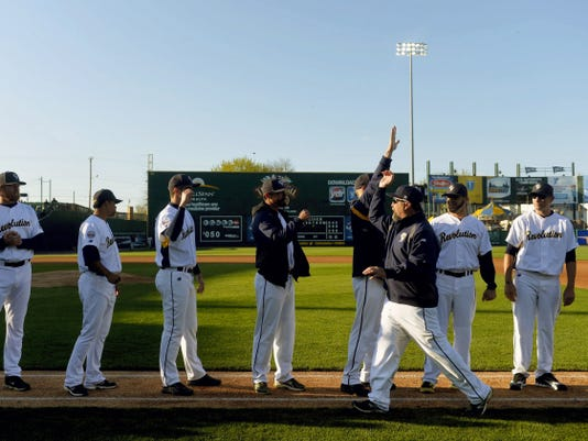 """York Revolution manager Mark Mason greets his team during team introductions on Friday. Said Mason of opening day of the baseball season, """"It's not an ordinary day. Everyone wants their first hit, their first play in the field. It's a lot of firsts."""""""