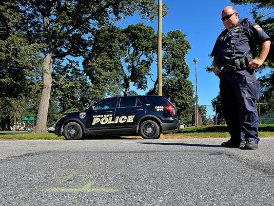 Officer Nicholas Hansel of the York City Police Department stands where a 3-year old girl was struck by a hit-and-run driver in the 100 block of Lafayette Street on Saturday Aug. 8. Hansel is asking anyone who witnessed the accident to come forward. The girl was critically injured and remains in Hershey Medical Center.