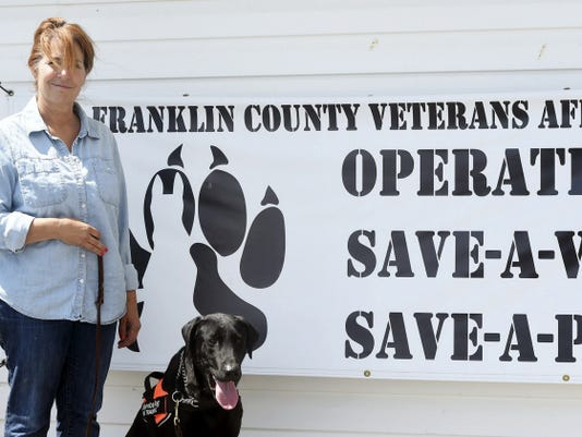 Helen Carson of the Good Dog training school lead training exercises with a future service dog for the Save-A-Vet, Save-A-Pet operation on Wednesday.
