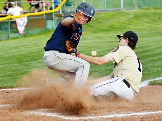 Dallastown's Cody Somerville steals home as Red Lion pitcher Kent Walker loses the ball in the fourth inning of an American Legion baseball game on July 10 at Shryock Field in York Township. Dallastown defeated Red Lion, 11-1.
