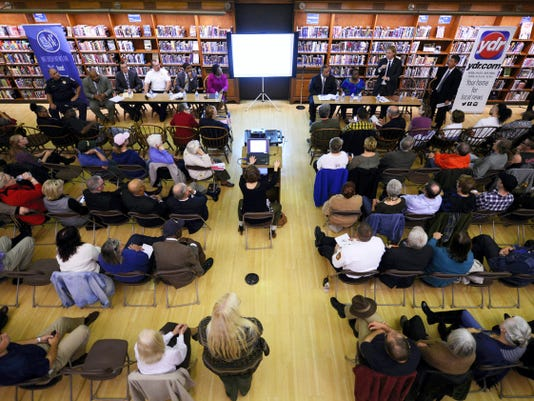 Community members listen during a Fixing York Community Conversation at Martin Library in York earlier this week. The goal of Fixing York, which began as a Facebook group, is to find solutions to issues facing York and make it a better place.