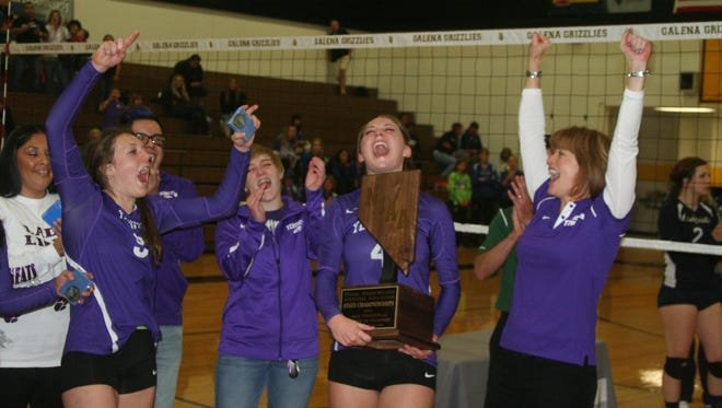 Yerington High School players and coaches celebrate after being presented their state championship trophy after beating White Pine in the Division III title match Saturday.