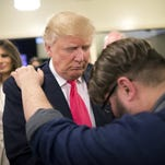 Pastor Joshua Nink prays for Donald Trump in Council Bluffs, Iowa, on Jan. 31, 2016.