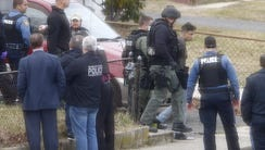 A man is taken into custody after being dragged from