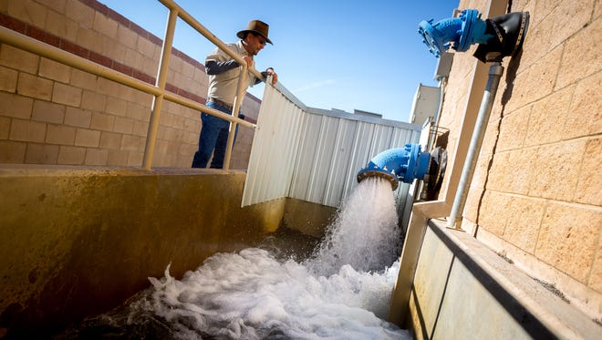 City of Las Cruces Acting Water Production Supervisor Pascual Rodriguez looks at water being discharged from Well 70 on South Espina Street, March 16, 2016. Rodriguez estimates that Well 70 can deliver up to 3,000 gallons of water a minute to the surrounding neighborhood. City officials say Las Cruces has never had the problem of lead in its water that has been seen recently in Flint, Michigan, and other cities.