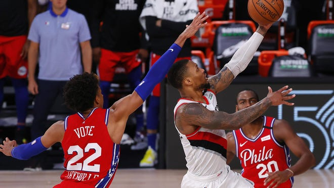 Damian Lillard of the Portland Trail Blazers goers up for a shot against Matisse Thybulle (22) of the Philadelphia 76ers during the fourth quarter at Visa Athletic Center at ESPN Wide World Of Sports Complex on Sunday in Lake Buena Vista, Florida.