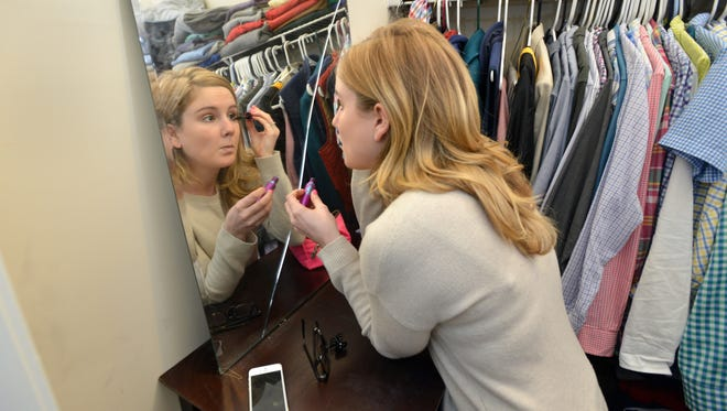 Rebecca Mersiowsky prepares before heading to her job as a sales associate at a boutique in Beacon Hilll in Boston.  Mersiowsky, a communication major who graduated from Radford University in 2012, has been looking for a full-time job in public relations ever since.