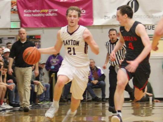Dayton's Tanner Lewis dribbles down court against Santiam Christian on Friday, March 2, 2018.