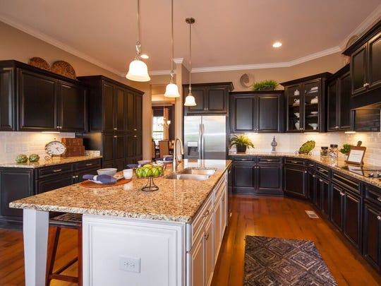 While dining rooms are disappearing, kitchens are getting bigger, with more homeowners requesting features like islands and premium materials such as granite.