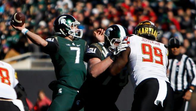 MSU quarterback Tyler O'Connor throws against Maryland Saturday, November 14, 2015, at Spartan Stadium.  MSU won 24-7.