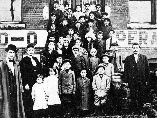 Children from Lawrence, Mass., are photographed on the steps of the Socialist Hall in Barre. The picture was made into postcards that were mailed to their parents. They were part of the Children's Exodus in 1912, sent by their families to Barre because of dangers from the Bread and Roses Strike involving textile workers in Lawrence.