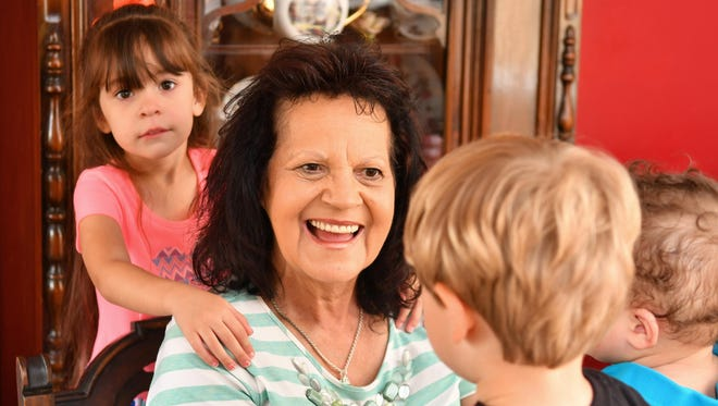 Barbara Gibbs of Titusville has fostered hundreds of children over the last 45 years, and is currently fostering two, as well as adopting Olivia, behind her in this photo.