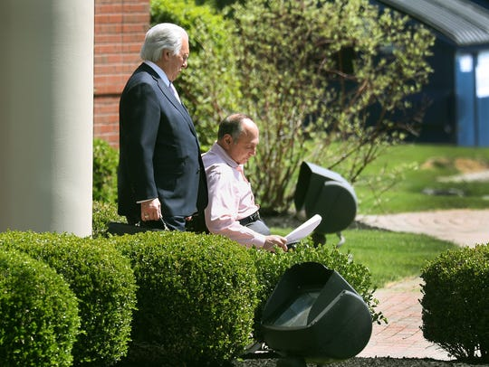 Robert Morgan and his attorney John Speranza leave