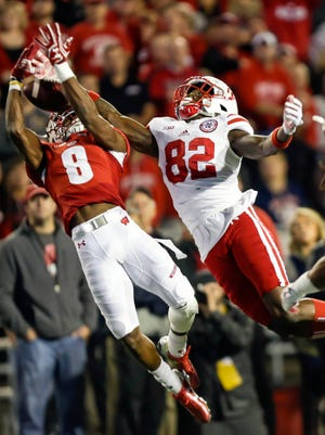 Wisconsin cornerback Sojourn Shelton (8) intercepts a pass intended for Nebraska wide receiver Alonzo Moore during the first half of an NCAA college football game Saturday, Oct. 29, 2016, in Madison, Wis.
