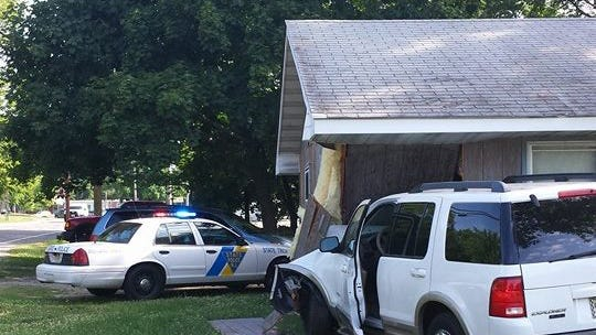 Police investigate after an SUV crashed into a home on Cherry Street and Fairton Road in Millville on Monday.