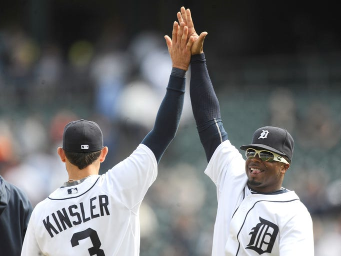 Tigers' Ian Kinsler (3) and Rajai Davis (20) celebrate