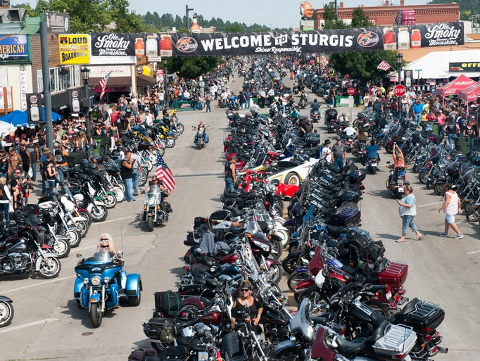 Bikers ride down Main Street on the first day of the