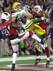 Green Bay Packers' Jeff Janis catches a touchdown pass from Aaron Rodgers at the end of regulation, tying the game against the Arizona Cardinals on Jan. 16, 2016, at the University of Phoenix Stadium in Glendale, Ariz.